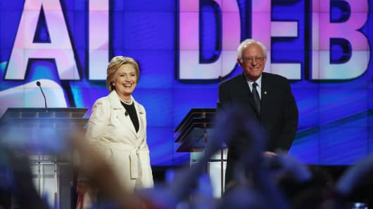 Democratic Presidential candidate Hillary Clinton stands with Bernie Sanders